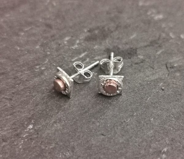 Stud Earrings sitting on a slate surface - handmade sterling silver stud earrings