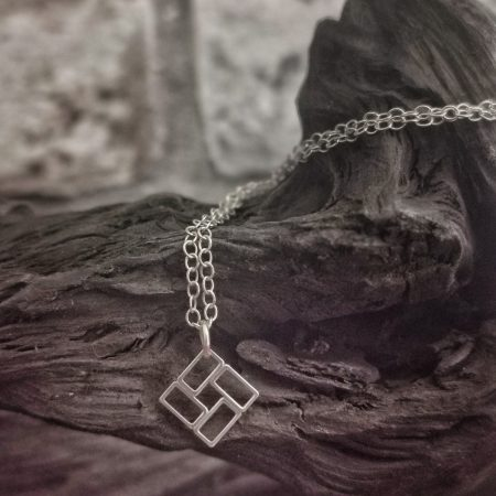 chain drapped on a piece of bog oak - sterling silver windmill necklace