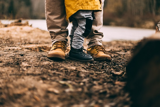Father standing with child in park - Fathers Day Gift Blog