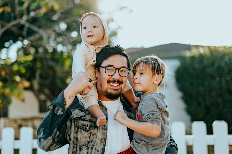 Father carrying children smiling on Father's Day- fathers day gift blog