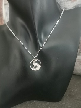 chain on a black pastic model - threepence irish coin necklace