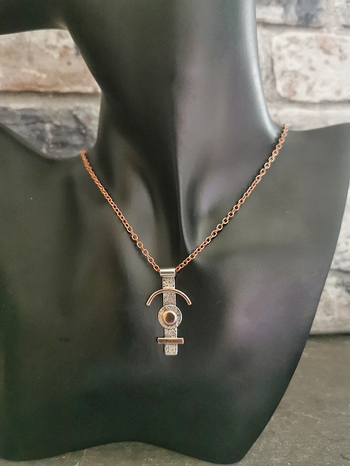 sterling silver and copper necklace hanging on a black plastic bust - unique handmade necklace