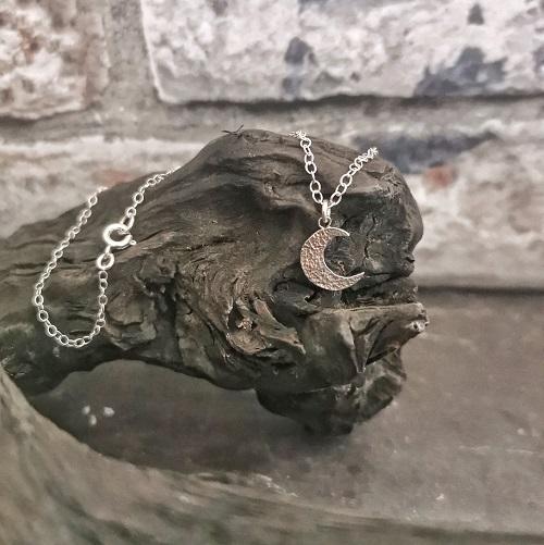 necklace displayed on bog oak- handmade moon necklace